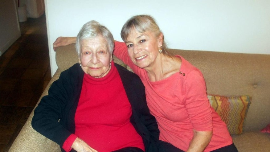 Rose Vermersch, 95, and her daughter, MariePaule Vermersch, 66, pose for a photo in their home in the Forest Hills section of the Queens borough of New York.
