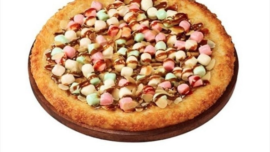 Pizza Hut Japan is offering a dessert pizza topped with marshmallows and caramel sauce.