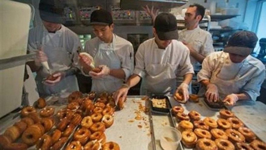 FILE: A baking crew makes Cronuts, a croissant-donut hybrid, at the Dominique Ansel Bakery in New York.