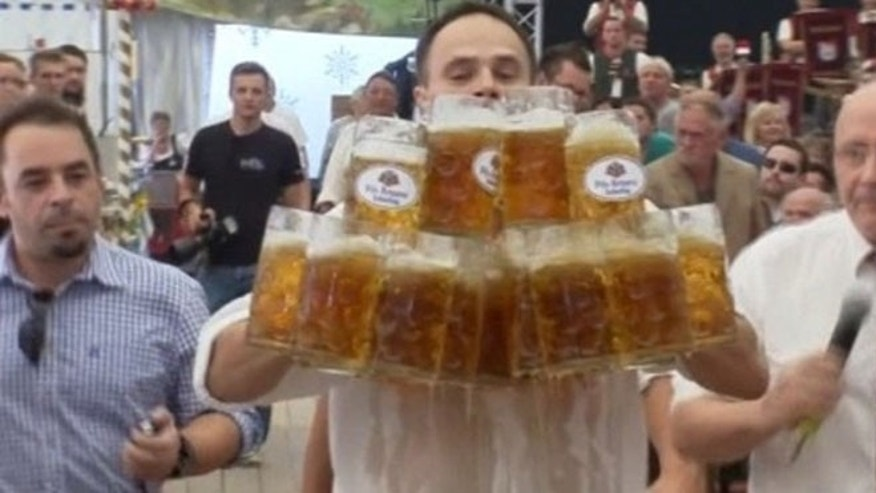 Oliver Struempfel carried beers weighing a total of 136 pounds for 130 feet.