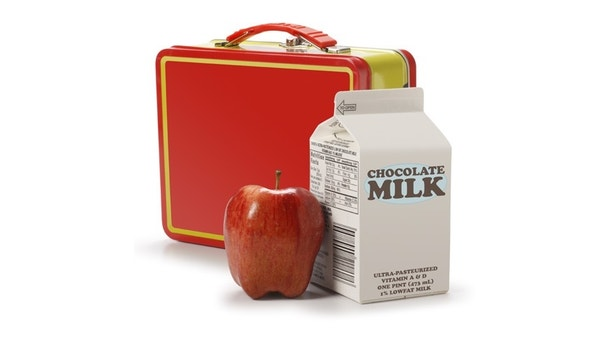 A milk carton, apple and lunchbox.