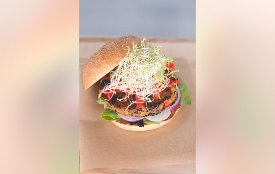 Sprouts top a veggie burger.