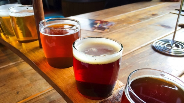 Craft beers are served together in a sampler tray for the beer enthusiast at a restaurant in Oregon.