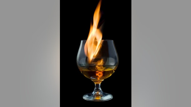 fire tongue inside glass, on black background
