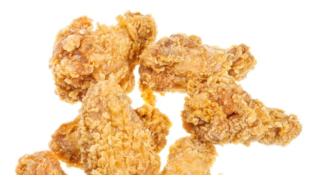 few hot fried chicken wings isolated white background