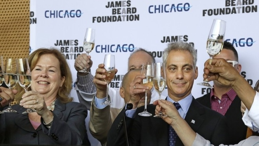Susan Ungaro, President of the James Beard Foundation, left, and Chicago Mayor Rahm Emanuel, right, toast to the JBF Awards.