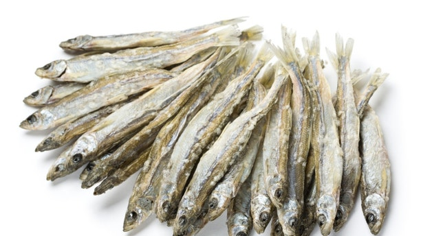 Dried salted sprat isolated on white.