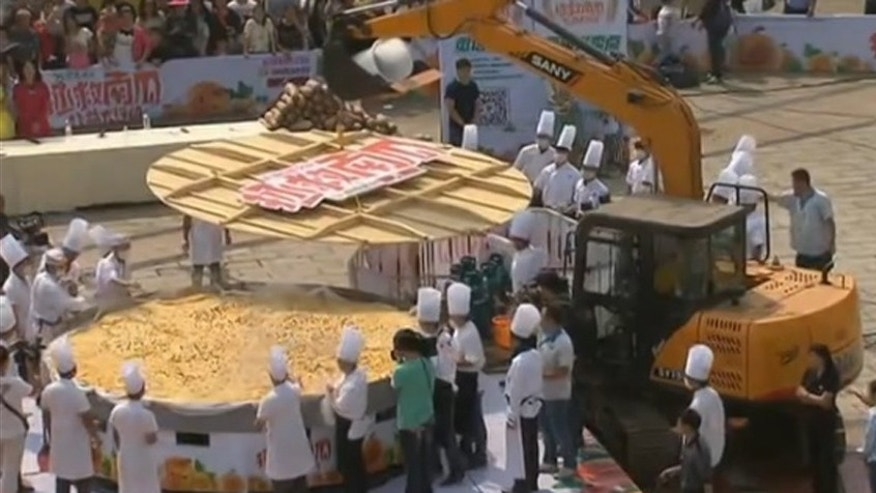 A crane pours the pumpkin batter into a massive steamer.