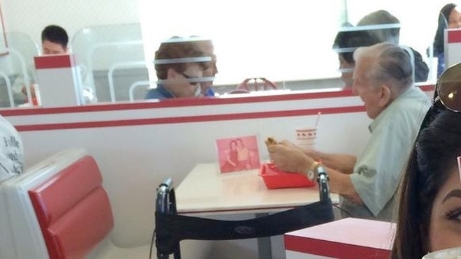 Photo of elderly man eating lunch with picture of deceased wife goes viral