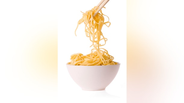 chopsticks,bowl and noodles on white background