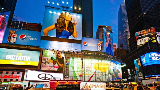 NEW YORK CITY -MARCH 25: Times Square, featured with Broadway Theaters and animated LED signs, is a symbol of New York City and the United States, March 25, 2012 in Manhattan, New York City. USA.
