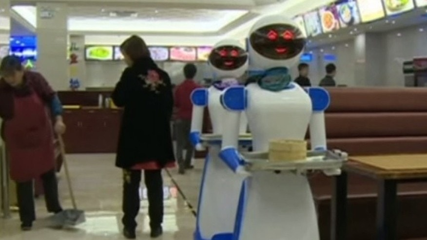 Robots deliver food at this Chinese restaurant.