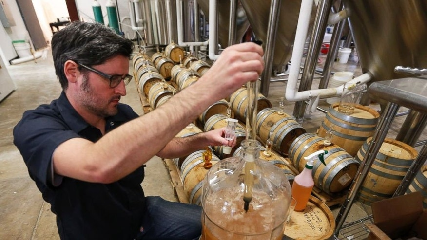 Co-Owner of Ardent Craft Ales, Kevin O'Leary, takes a sample of Persimmon beer at the facility in Richmond, VA.