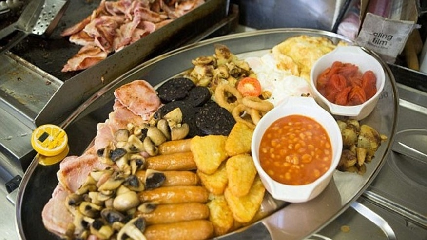 This gut-busting 8,000-calorie breakfast includes bacon, sausages, eggs, black puddings and hash browns, two three-egg omelettes and four portions each of fried potatoes and fried mushrooms.