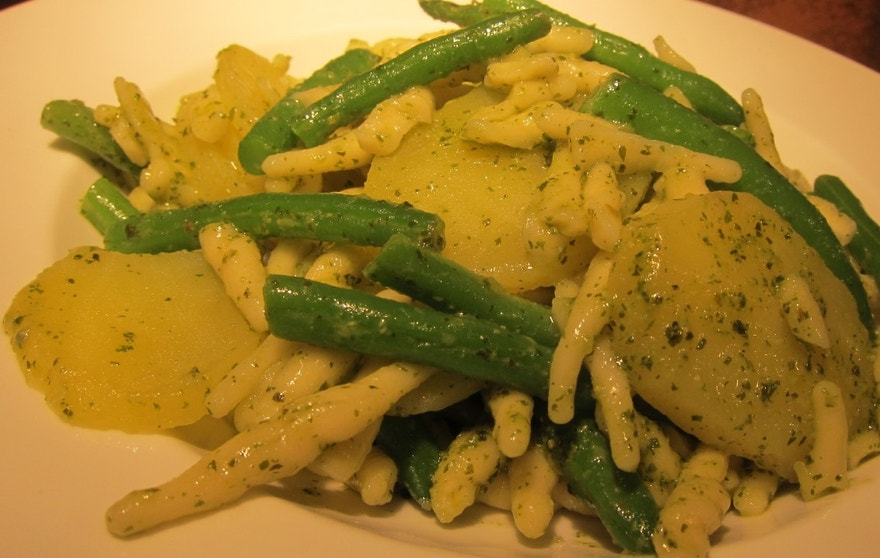 Troife con Pesto, a traditional pasta dish from Liguria. The tradition in Liguria is to cook string beans and slices of potato in the boiling water with the pasta and to let these vegetables remain in the finished dish. If you can't get the trofie, this recipe is also good with small penne or linguine.