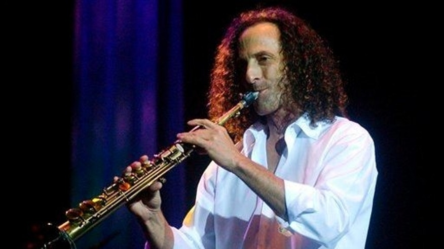 "Saxophonist Kenny G performs during his concert ""Rhythm & Romance"" at Hong Kong's Asia World Expo, Friday, May 9, 2008."