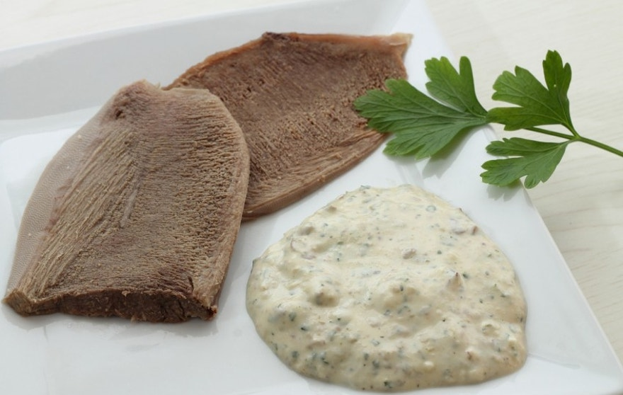 Slices of veal tongue with bagnet verd (parsley sauce)