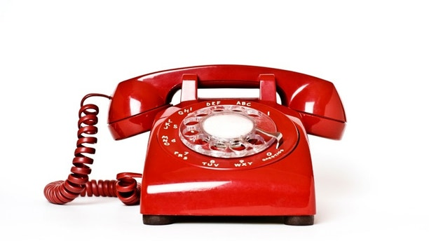 Isolated red phone.