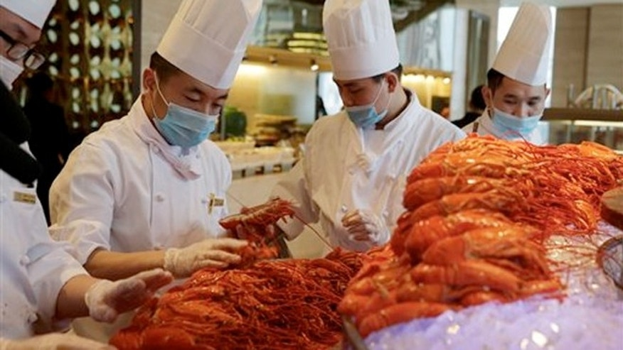 Feb. 9, 2015:  Chinese chefs prepare Boston lobsters at the Auspicious Garden restaurant in Pangu Seven Star Hotel in Beijing.