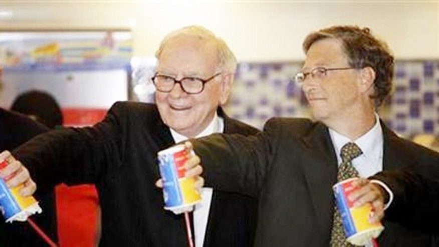 Warren Buffet (L) and Bill Gates test out Dairy Queen Blizzards.