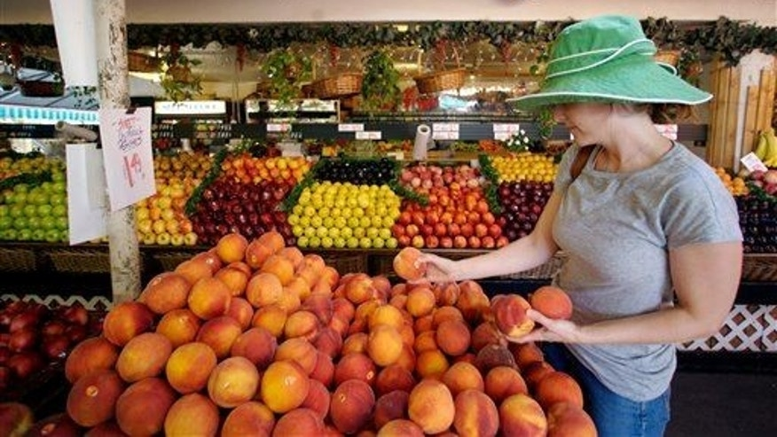 Tara Igoe shops for sweet California peaches at a fresh produce stand at the Farmers Market in Los Angeles, Wednesday, Aug. 15, 2007.