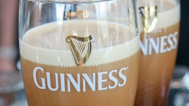 Dublin, Ireland - June 19, 2008: Two pints of beer served at The Guinness Brewery, founded by Arthur Guinness in 1759, where 2.5 million pints of stout are brewed daily