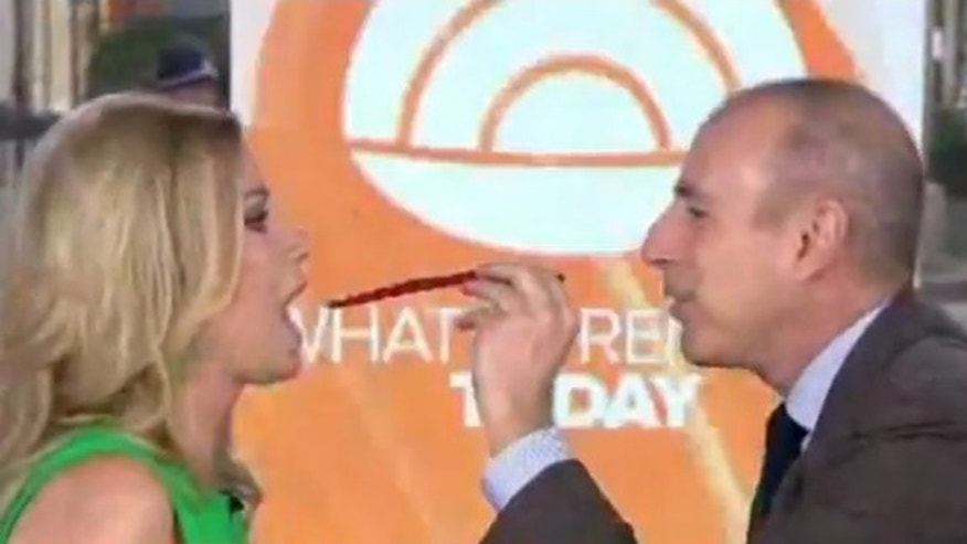 Matt Lauer and Kathie Lee Gifford prepare to take on the Twizzler Challenge.