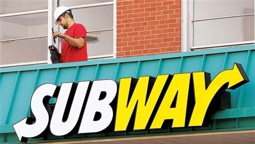 A Subway restaurant is shown Wednesday, Oct. 1, 2014, in the Washington Square strip mall in Alton, Ill.