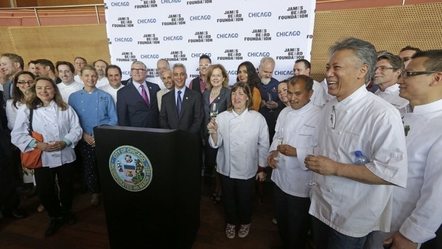 President of the James Beard Foundation Susan Ungaro poses with Chicago Mayor Rahm Emanuel and city chefs to announce the new ceremony location for its 25th anniversary.