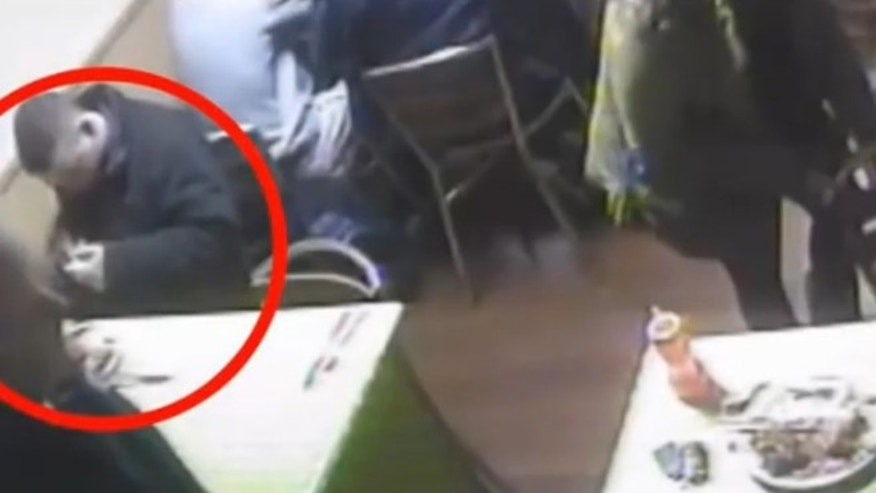 Surveillance footage catches a man pulling a rat from his pocket while dining at a restaurant.
