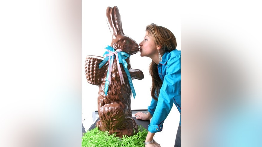 Dylan Lauren plants a smooch on a larger-than-life chocolate bunny.