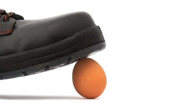 egg under the black shoe ready to squish it