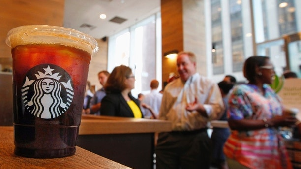An iced coffee sits on a counter in a Starbucks outlet in New York July 25, 2012. Starbucks Corp. will report earnings on July 26.  REUTERS/Brendan McDermid (UNITED STATES - Tags: BUSINESS) - RTR35BIA