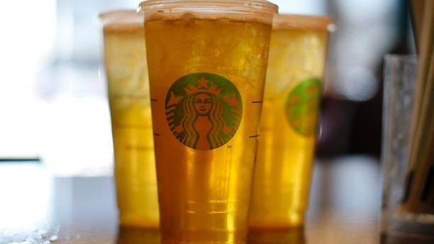 Freshly made drinks await customers at a newly designed Starbucks coffee shop in Fountain Valley, California August 22, 2013.  REUTERS/Mike Blake  (UNITED STATES - Tags: BUSINESS FOOD) - RTX12TYD