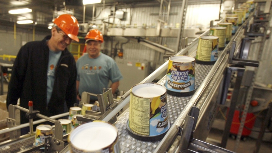 Chunky Monkey ice cream pints move along the production line at Ben & Jerry's factory in Waterbury, Vt.