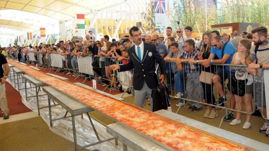June 20, 2015: Judge of the Guinness World Records Lorenzo Veltri checks the length of a pizza at the Expo 2015 world's fair in Rho, near Milan.