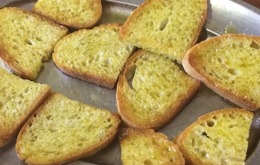 Matteo's wife, Francesca offers visitors toasted slices of bread with their signature extra virgin olive oil.