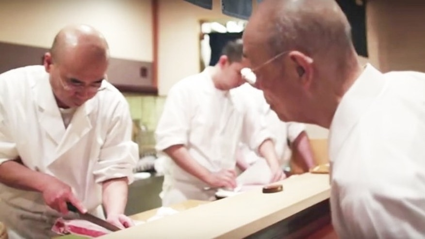 "Jiro Ono inspects son Yoshikazu Ono's knife skills in a clip from ""Jiro Dreams of Sushi."""
