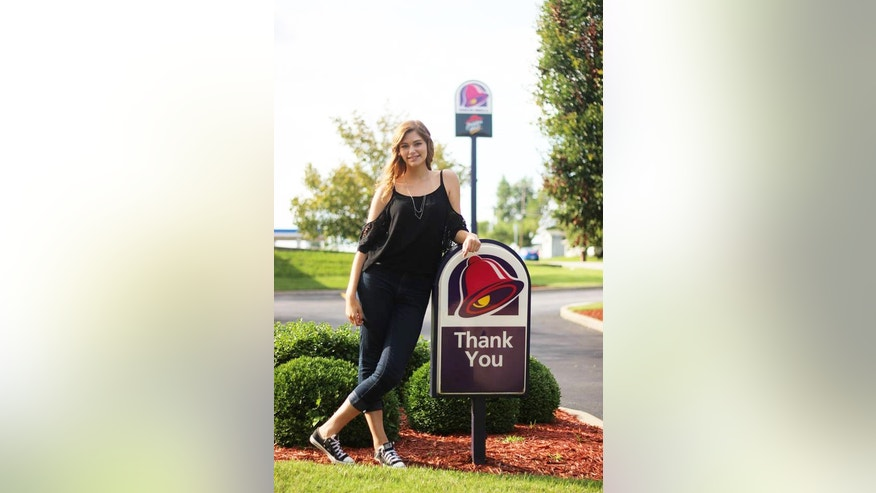 Brittany Creech poses outside of her local Taco Bell.