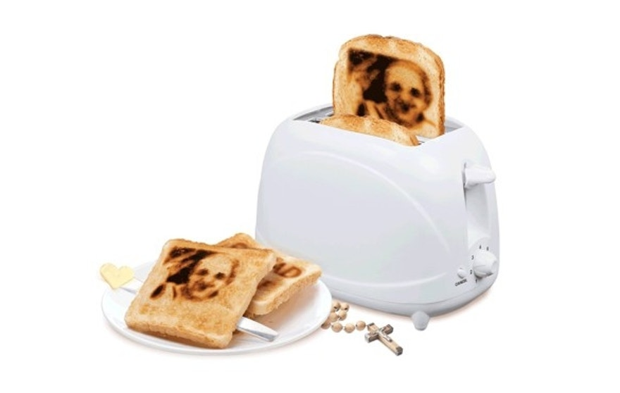 This toaster comes with interchangeable plates to create a likeness of His Holiness on bread.
