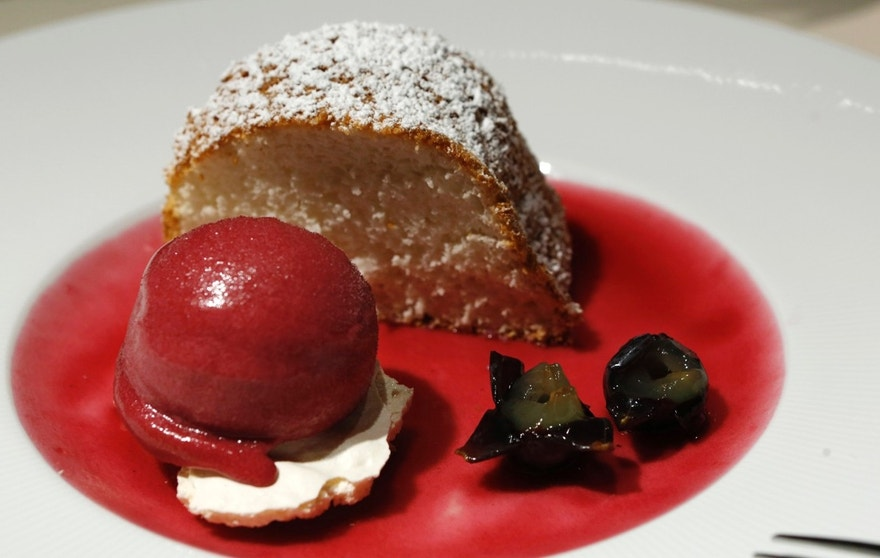 In this Sept. 17, 2015 photo, angel food cake with raspberry sorbet over a merengue and grapes is displayed at Felidia restaurant in New York. Restaurant owner Lidia Bastianich and restaurateur Angelo Vivolo, who served meals to Pope Benedict XVI, were chosen to prepare meals for Pope Francis during his time in New York. (AP Photo/Kathy Willens)
