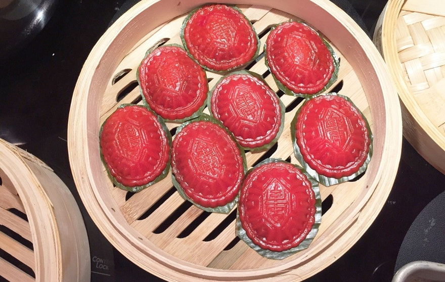 "Ang Ku Kueh, ""Red Tortoise Cake,"" is a traditional dessert in Singapore with Chinese influences."