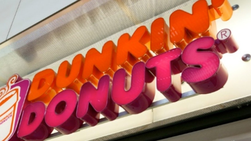 "Dunkin' Donuts' has released its seasonal cup that features wreaths and the word ""Joy."""