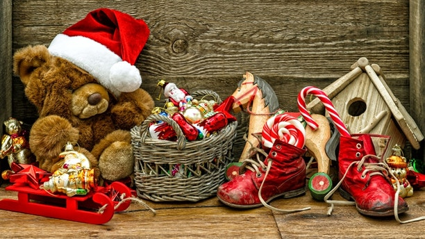 nostalgic christmas decorations with antique toys over wooden background. retro style toned picture