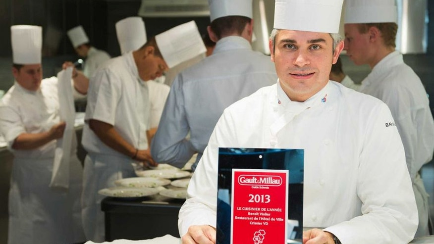 FILE: Chef Benoit Violier poses with the certificate as Chef of the year in his kitchen in the Hotel de Ville in Crissier, Switzerland.