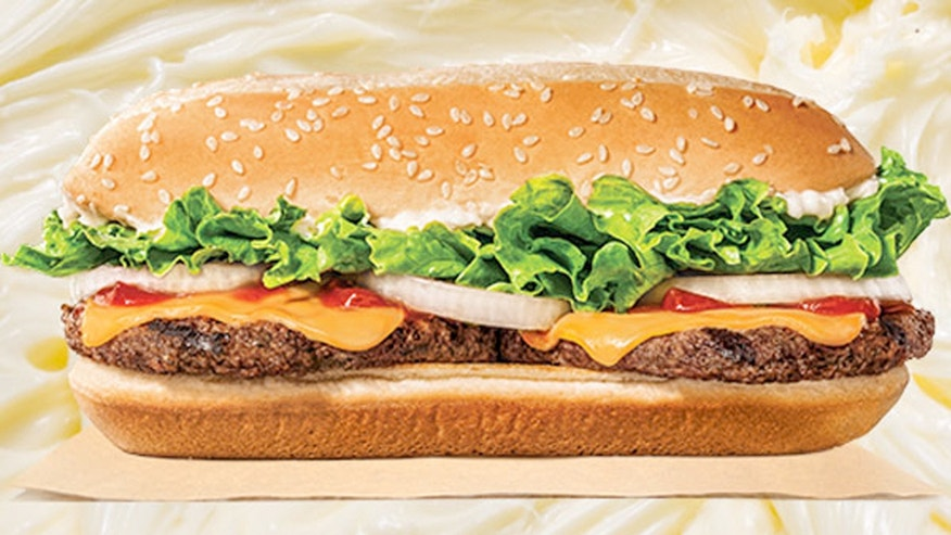 With all the fixings, the Extra Long Buttery Cheeseburger has 710 calories and has a whopping 1250mg of sodium, 47g of fat and 1.5g of trans fat.