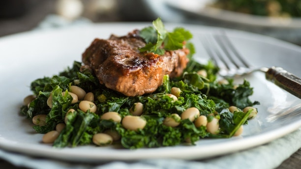 Lamb on sauteed kale with white beans and cilantro