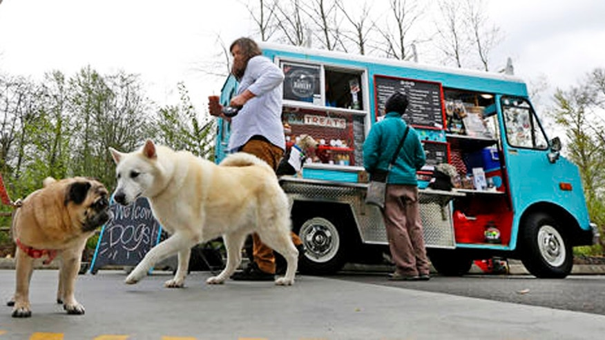 The Seattle Barkery serves dogs and their owners at Seattle-area dog parks, office building parking lots, farmer's markets and private events.
