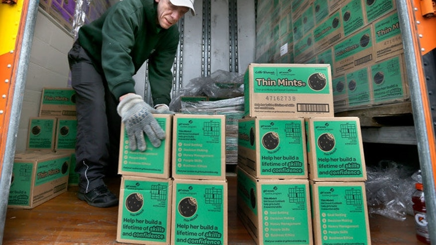 A truck driver unloads Girl Scout cookies in this file photo.