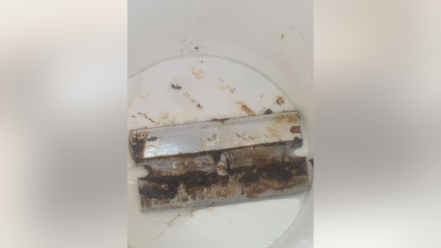 This slime-covered razor blade was allegedly found in a fountain drink from a local Wendy's restaurant.